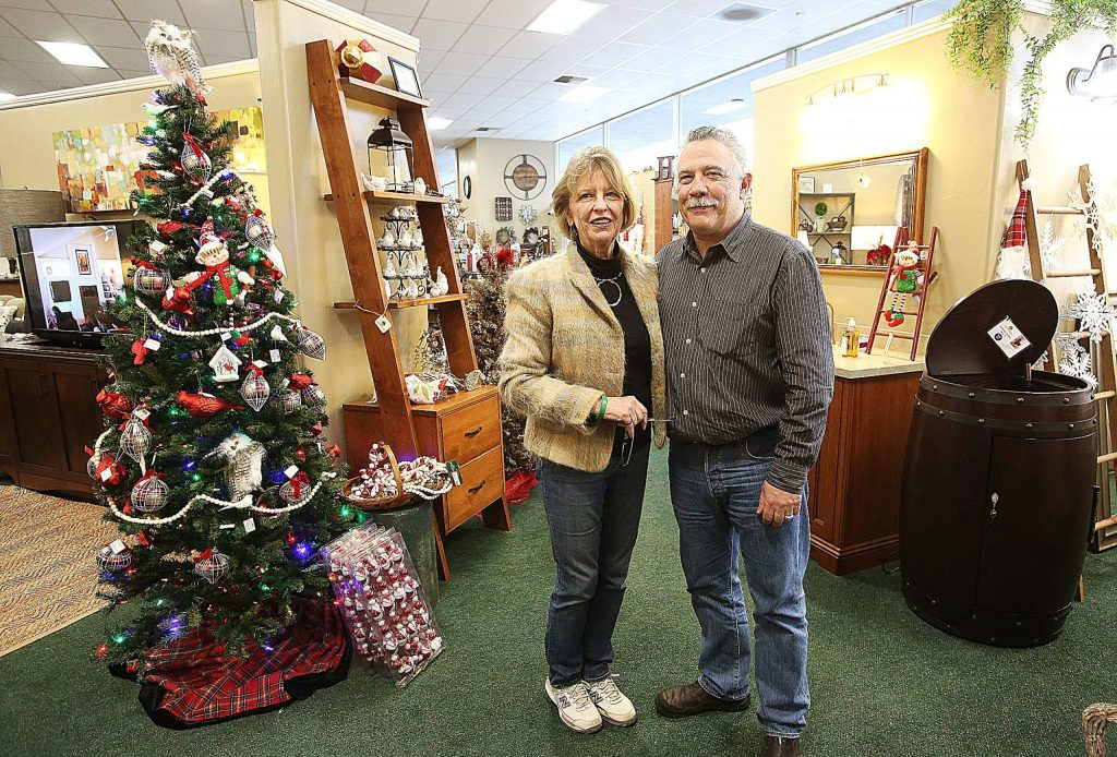 Owners Joe and Edwina Grande stand in their spacious sales room floor that they will be liquidating. The cabinet and shelve making part of the business will remain.