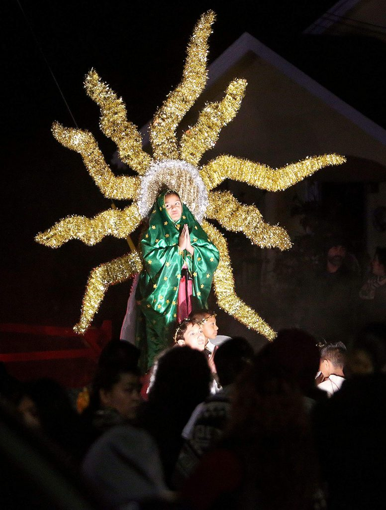 A young St. Patrick's Catholic Church parishioner portrays the Virgen De Guadalupe in a processional that took place along Church Street in downtown Grass Valley.