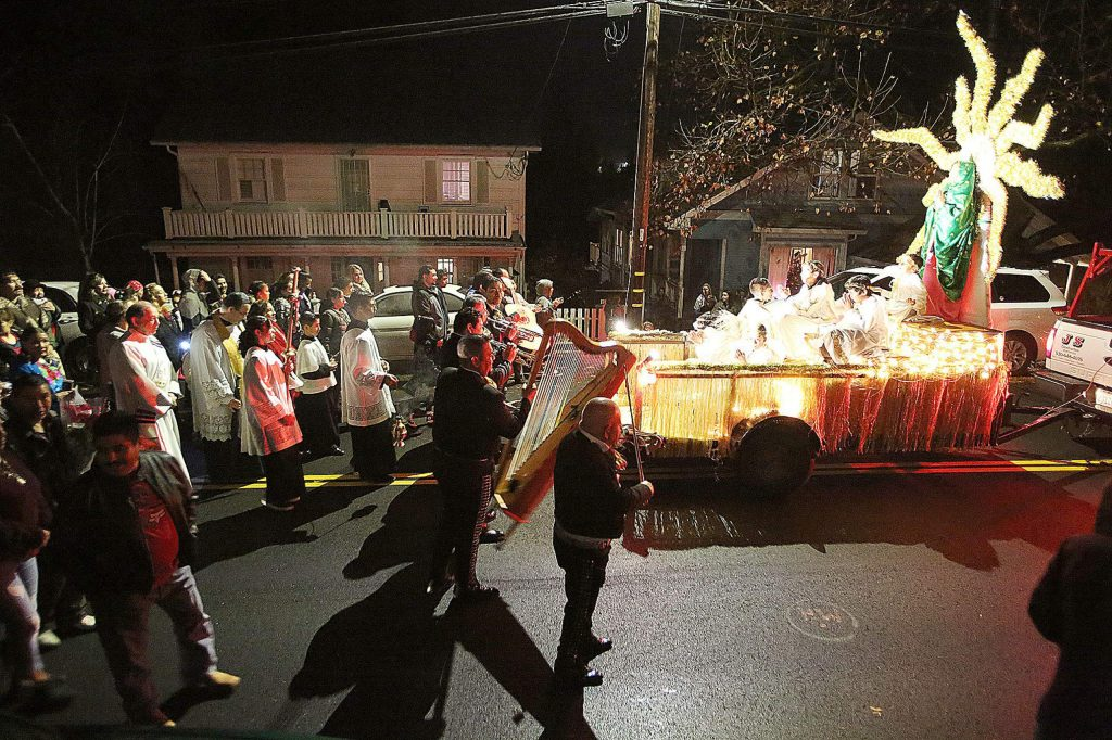 The processional for the Feast of La Virgen De Guadalupe approach St. Patrick's Catholic Church along Church Street in downtown Grass Valley Thursday evening.