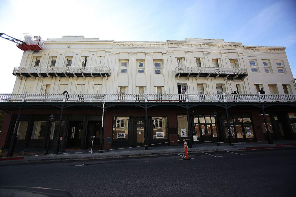 46) The National Exchange Hotel showed us different faces in 2019, from green, to white, to red as sown in November when a layer of white is painted over the former green.