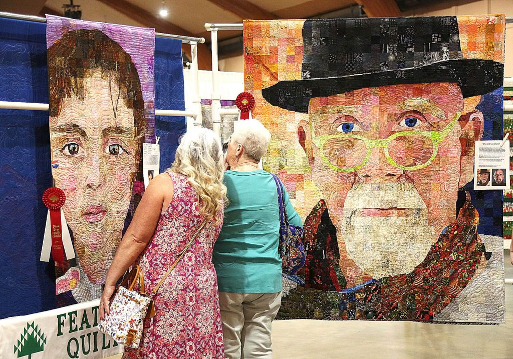 48) Folks were amazed at featured quilter Sandra Bruce's detailed and lifelike portraits sewn into her quilts on display at the annual Quilt Show in May.