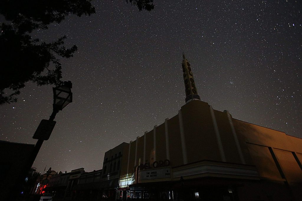 13) The Del Oro Theater in downtown Grass Valley is silhouetted by the star-studded night sky during an October power shutdown.