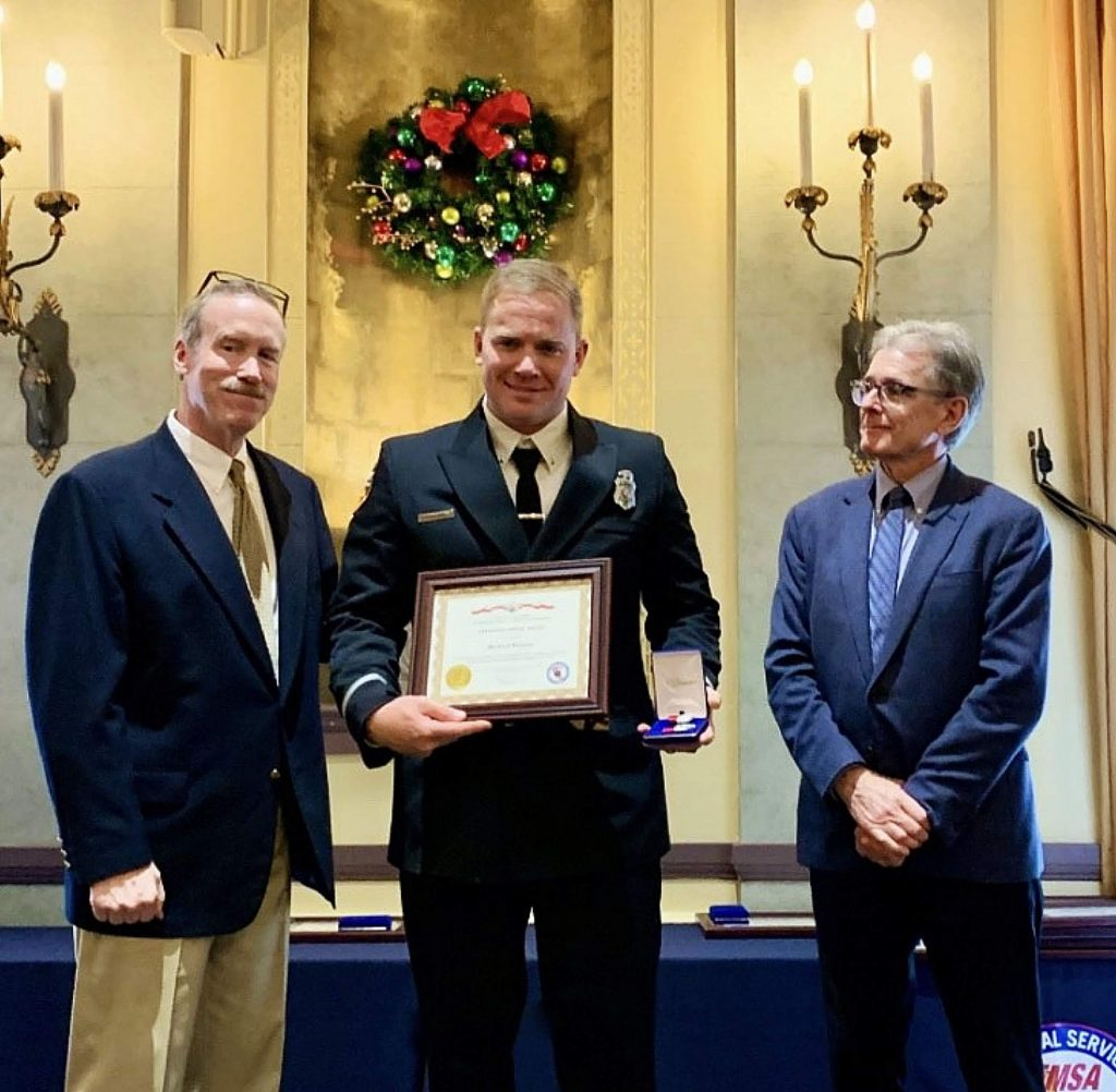 Richard Wilson of Penn Valley, center, was recently awarded a Lifesaving Medal from the California Emergency Medical Services Authority for saving a 4-year-old boy from drowning.