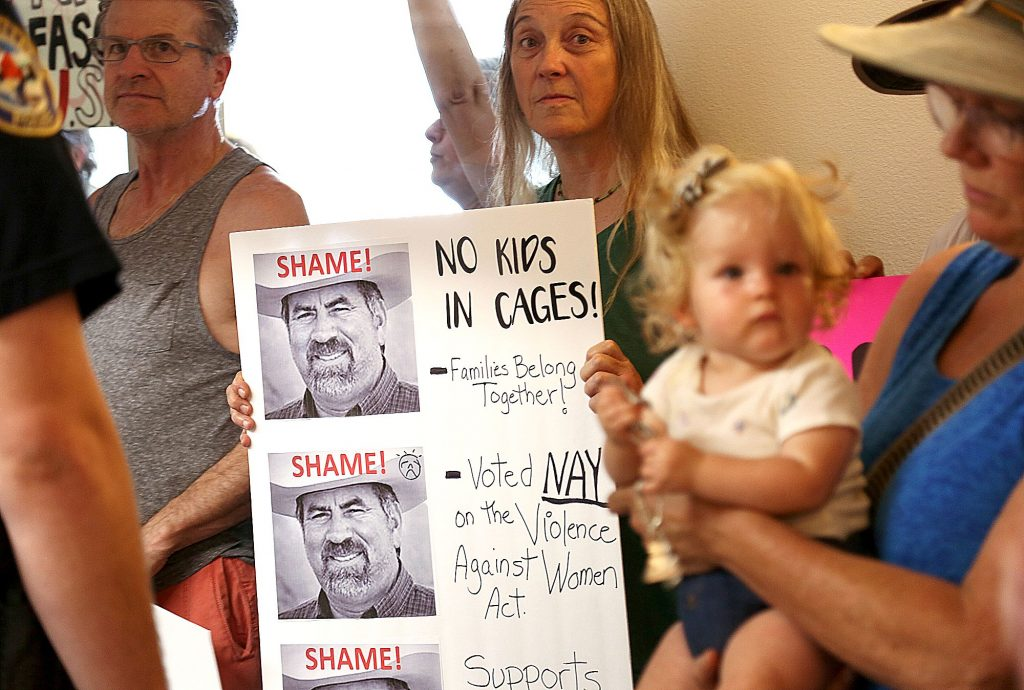 44) Members of the standing room only crowd held signs in opposition of Congressman Doug LaMalfa's policies during his visit to the Grass Valley City Council Chambers in August.