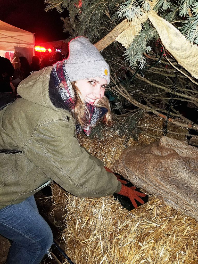 Grass Valley city worker Taylor Day decorated the 15-foot tall living Christmas tree and then flipped the switch at Grass Valley's downtown tree-lighting ceremony.