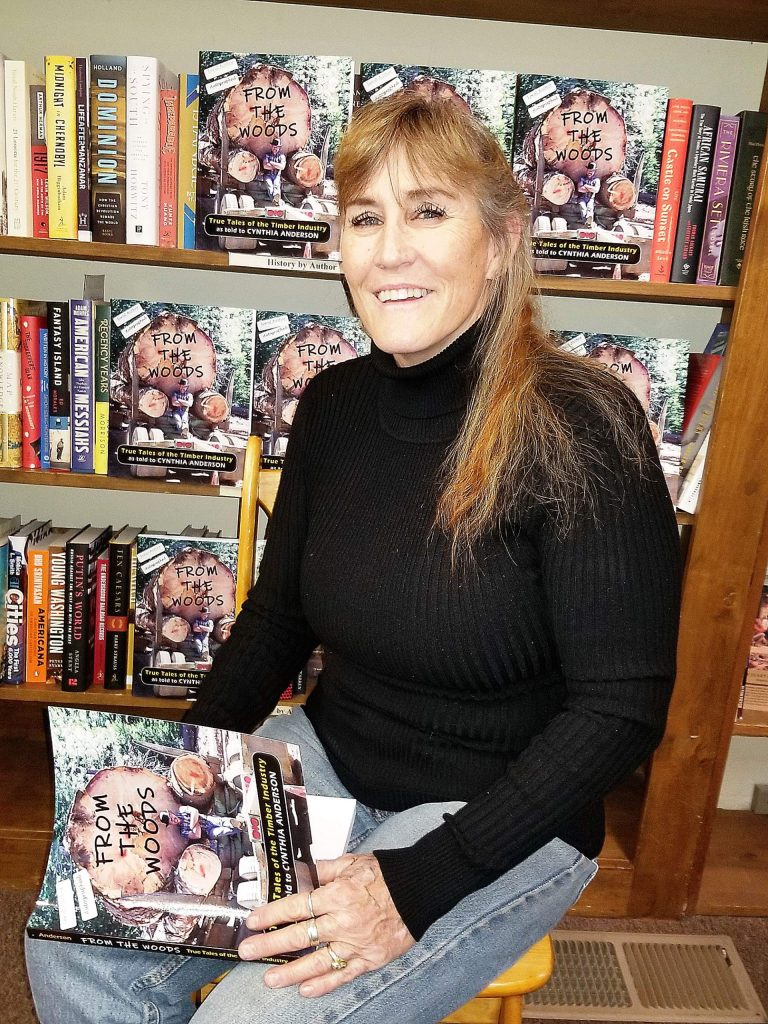 """For her book """"From the Woods: True Tales of the Timber Industry,"""" Cynthia """"Cindi"""" Anderson interviewed 50 people whose work in the timber industry helped shape western Nevada County. Here, Anderson signs one of her books at the Book Seller in Grass Valley."""