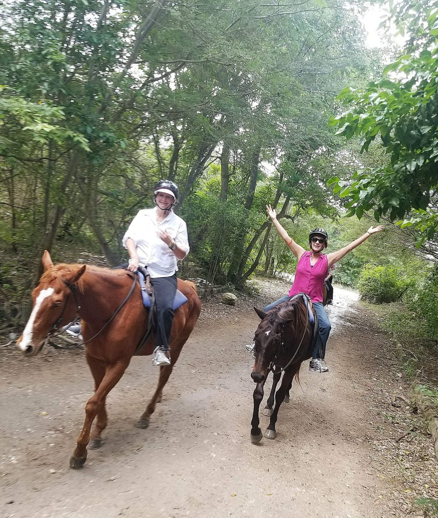 Fellow horseback rider Teresa Falkenstein, left, and I discovered that horses need not be steered after their umpteenth trip down the trail.
