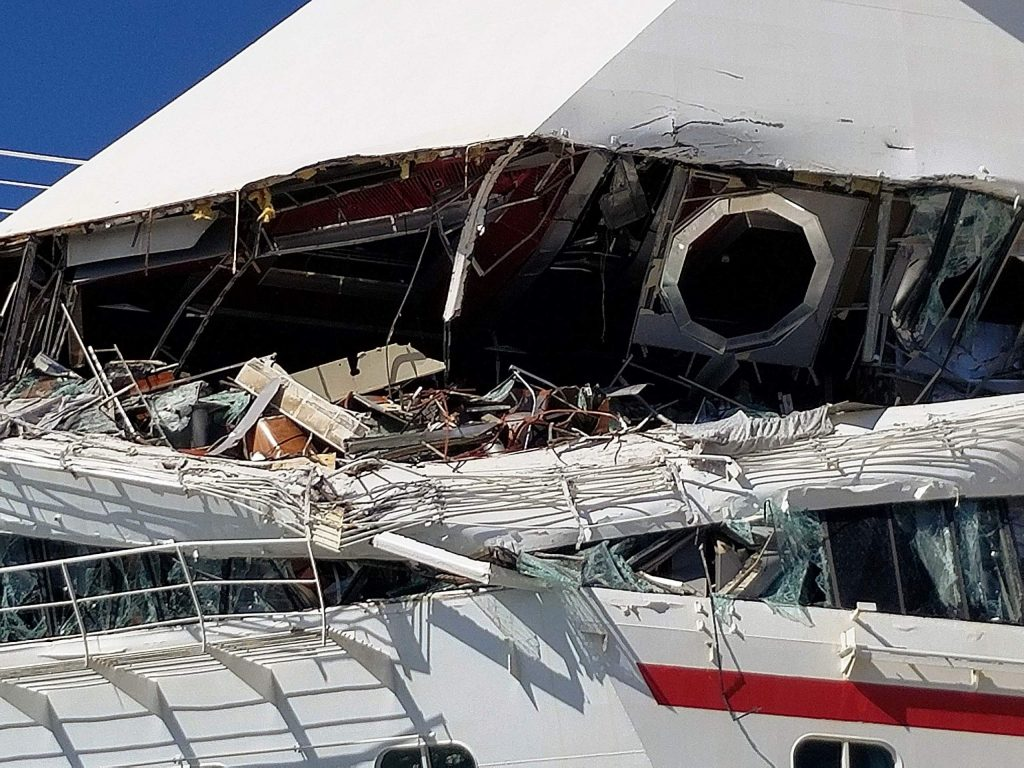 Ooops and Ouch. A damaged Carnival cruise ship now offers open-air dining.