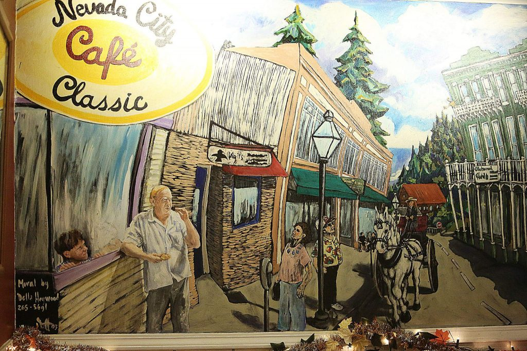 The interior of Nevada City Classic Cafe is decorated with an extensive mural of Broad Street, which adds to the cozy French Parisian accents.