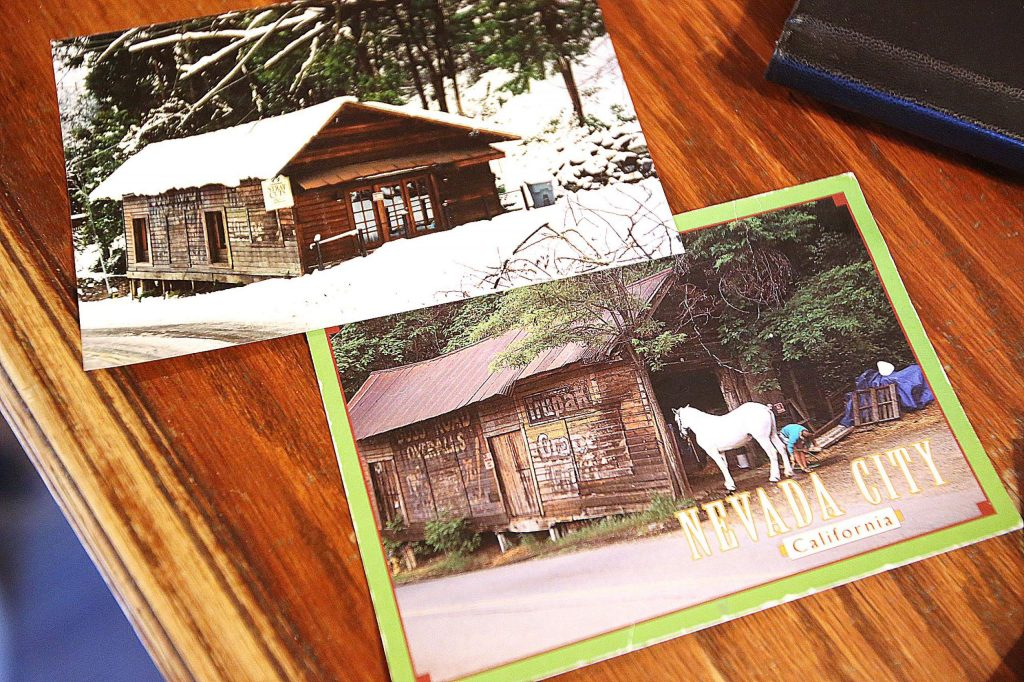 A couple of old postcards show the Stray Cuts building when it was used as a horse barn and in the snowfall after its current remodel.