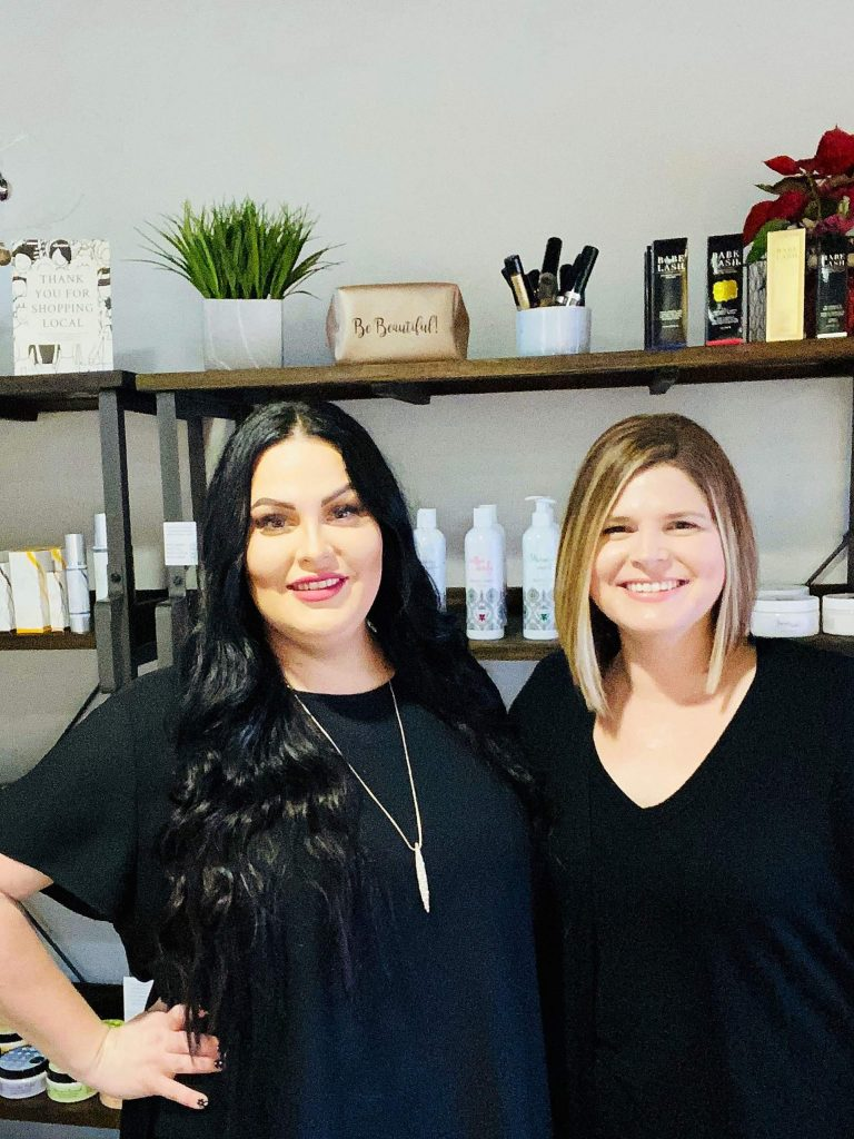 From left, sisters Alissa Hicks and Alanna Haley pose in front of a full line of products made by V'TAE Parfum & Body Care at Blondies Salon in Grass Valley. Blondie's is now serving as the storefront for V'TAE, which has a manufacturing and wholesale facility in Cedar Ridge.