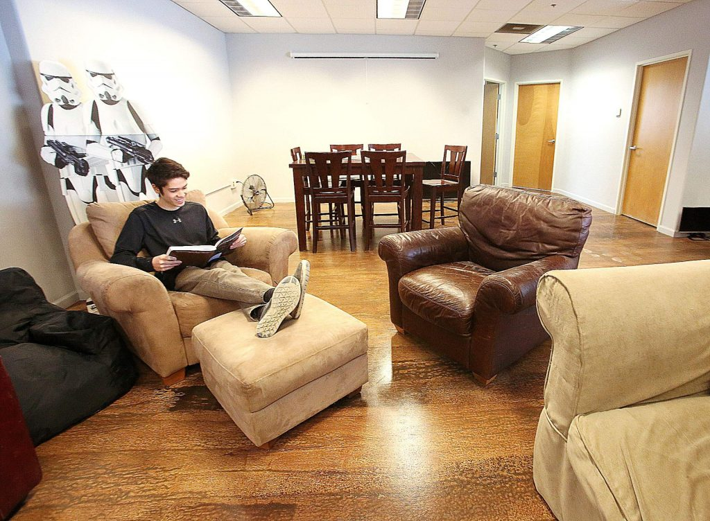 Forrest Chew reads a book at Nevada County Media's spacious lounge and entry area off of Crown Point Circle.