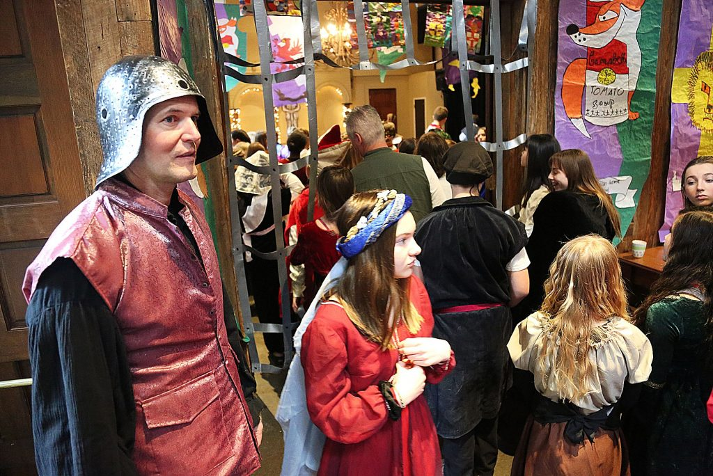 32) Nevada City's Bryan McAlister stands guard over the annual Seven Hill Middle School Medieval Feast held at the Miner's Foundry in March.