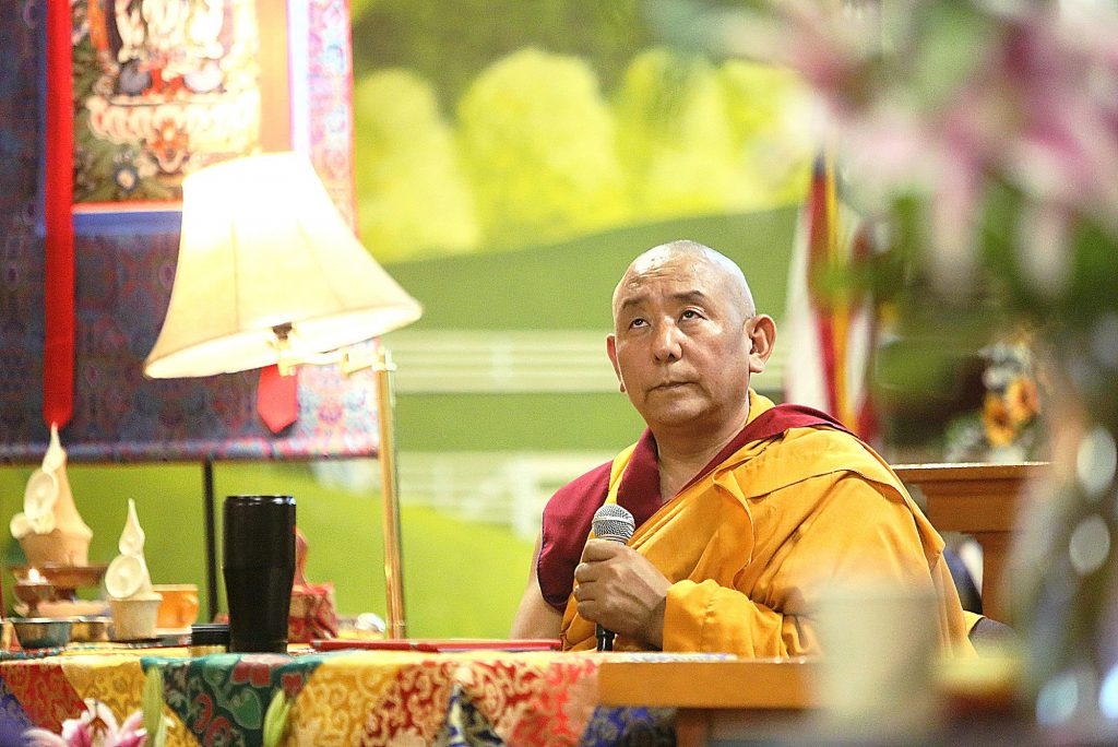 29) Tibetan Monk Geshe Wangyal of the Gaden Shartse Monastery gathers his thoughts at the Banner Community Hall in Grass Valley while giving an information session on the six delusions during their visit to the area earlier this year.