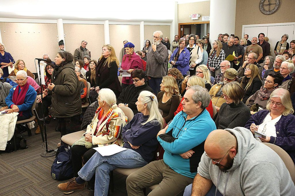 A standing room only crowd of community members waited in line to speak during the public comment period regarding the potential removal of Mayor Reinette Senum's title.