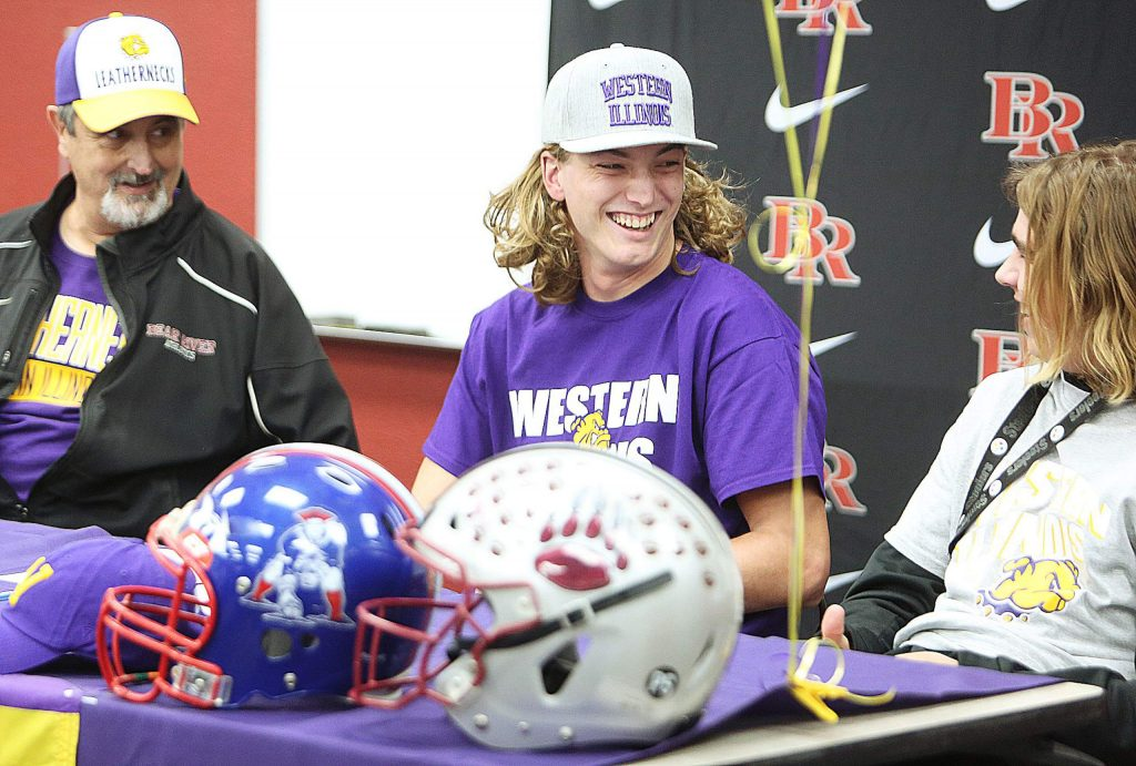 Tre Maronic smiles after signing his letter of intent to play college football for the Western Illinois Leathernecks Wednesday at Bear River High School.