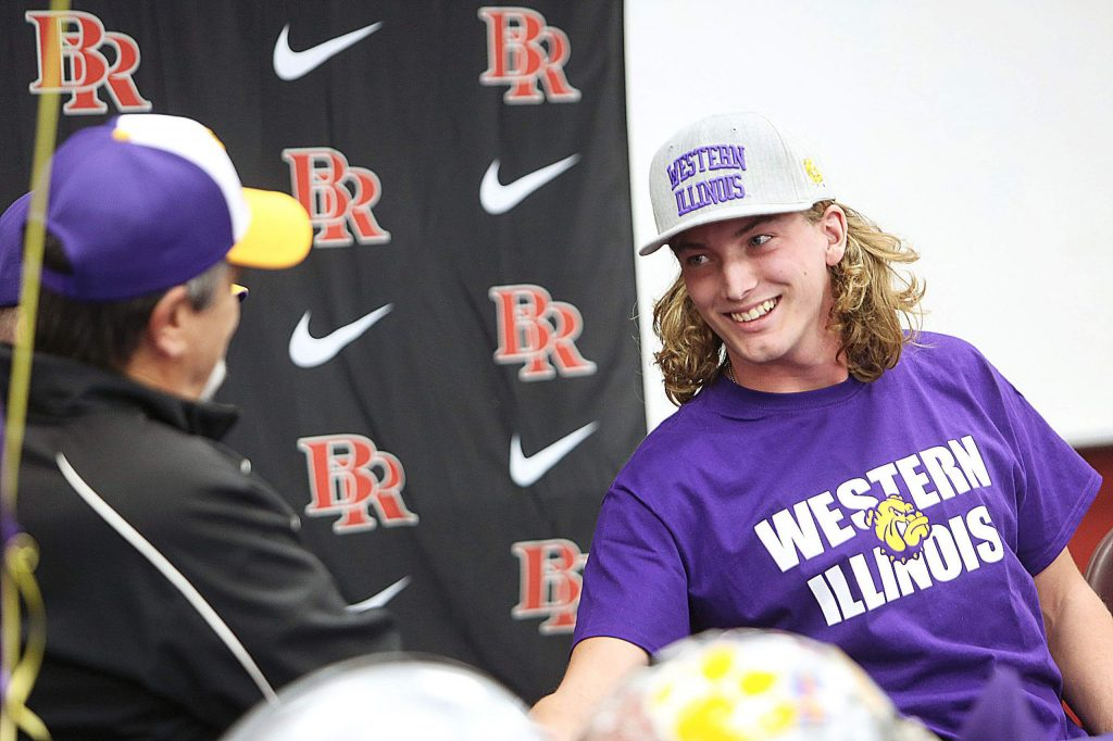 Bear River High School senior Tre Maronic smiles as he shakes the hands of his high school football head coaches Terry Logue and Scott Savoie after signing his letter of intent to play D-1 college football for Western Illinois. Maronic received a full ride scholarship for four years from Western Illinois.