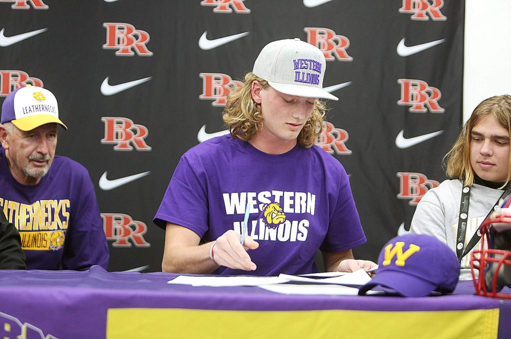 Flanked by his high school coaches, fellow athletes, and friends and family, Tre Maronic signed his letter of intent to attend Western Illinois college and play football.
