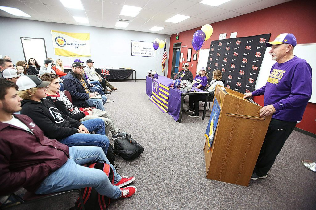 Bear River co-head coach Terry Logue gave a few words of encouragement during Tre Maronic's signing day Wednesday at Bear River High School.