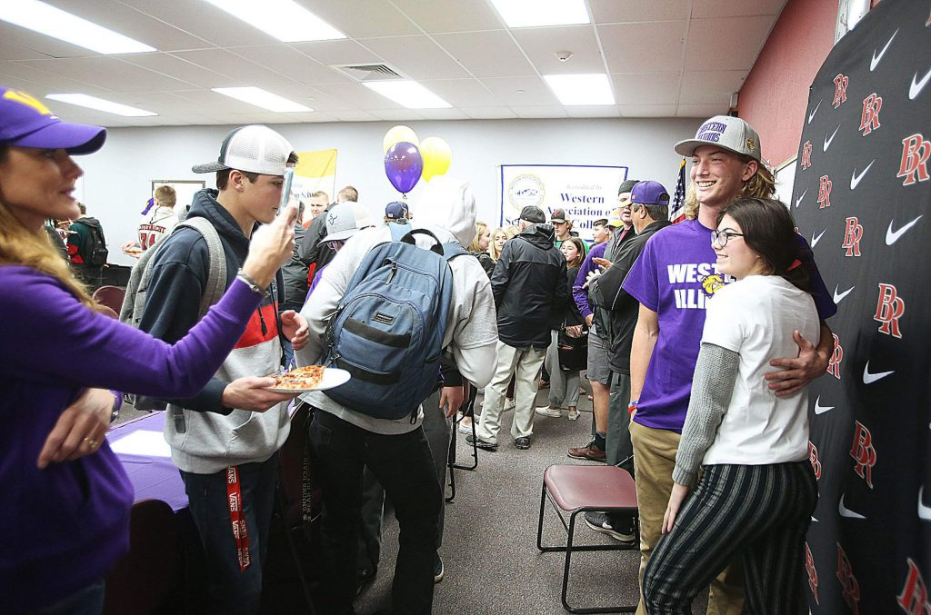 About 70 people showed up to witness Tre Maronic's letter of intent signing for Western Illinois college Wednesday at Bear River High School.