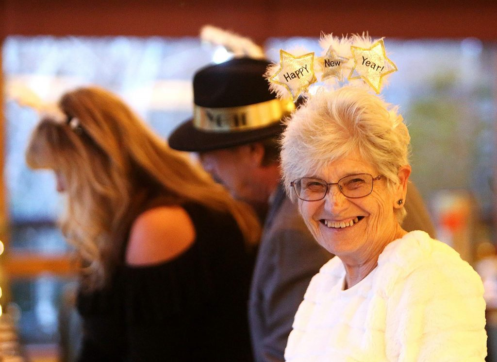 Alta Sierra's Darlene Jamison smiles as she finds her dinner place and dons her New Years attire.