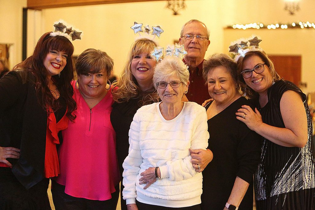 Happy smiling faces were all ready to welcome in the new year Tuesday at the Alta Sierra Country Club.