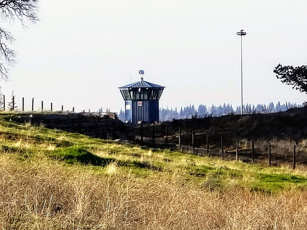 A watertower can be seen from the trail.