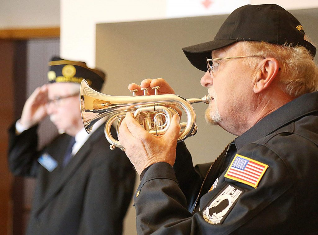 Ralph Remick plays taps for those in attendance of the ceremony on his pocket trumpet.