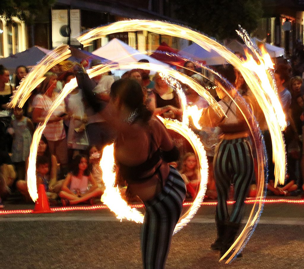 4) Sol Risers fire dancers capture the attention of those at downtown Grass Valley's Thursday Night Market in July.