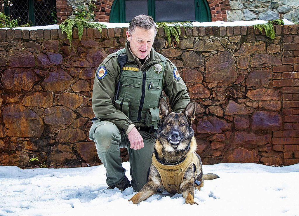 Ranger Martin Gilbertson and K9 Miro welcome folks to the