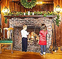 Kids enjoying the warmth of the fire place in the Clubhouse as they await their special time with Santa!