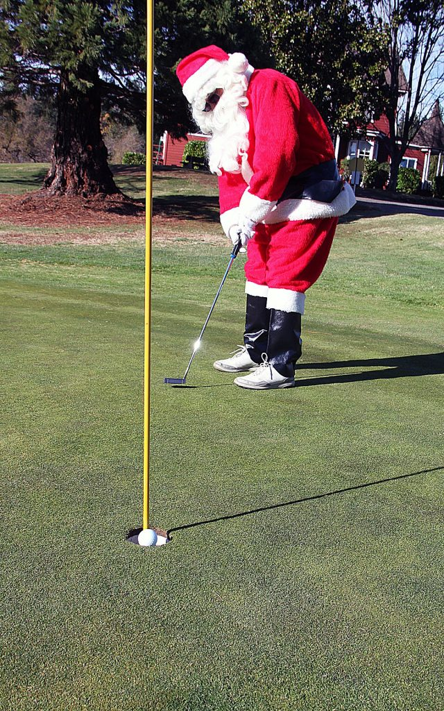 Santa Claus squeezes in a round of golf on Friday (Dec. 6) at the Nevada County Country Club.  He