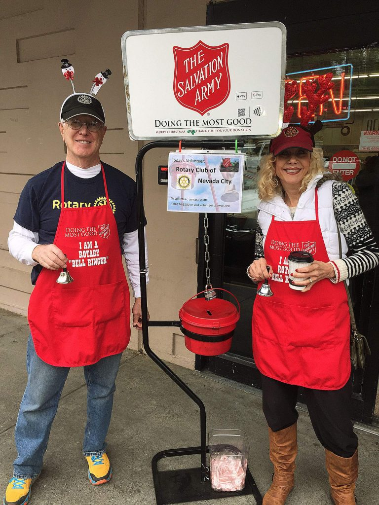 Some volunteers from the Nevada City Rotary helping out at the Salvation Army collection bucket.