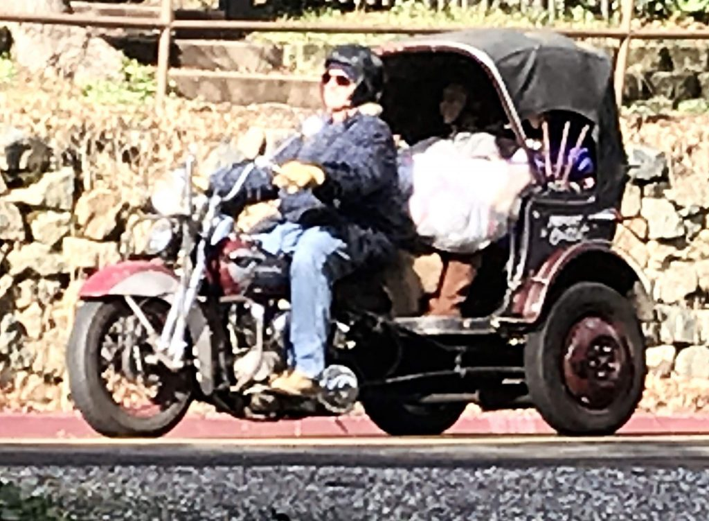 Some of the many, many bikers on Mill Street on their way to the Nevada County Fairgrounds.