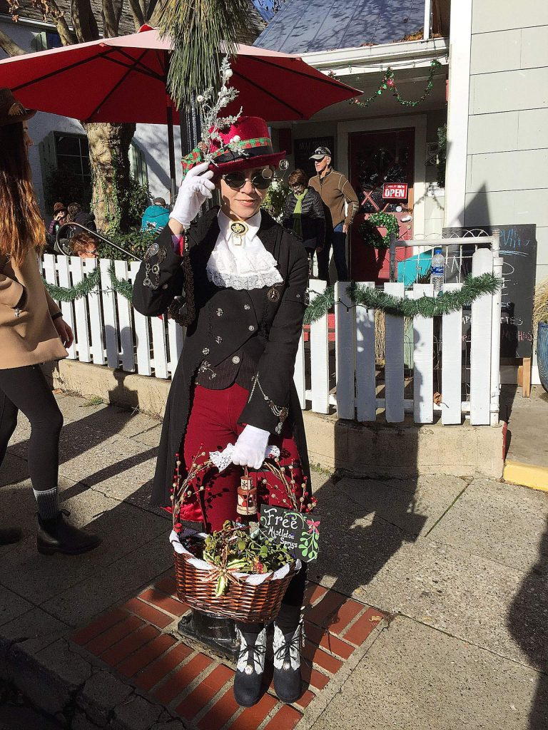 A Christmas spirit was spotted at Victorian Christmas giving out free sprigs of mistletoe.