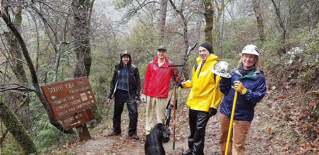 Bicyclists of Nevada County volunteers braving the rain to give some much needed love to the South Yuba Trail.