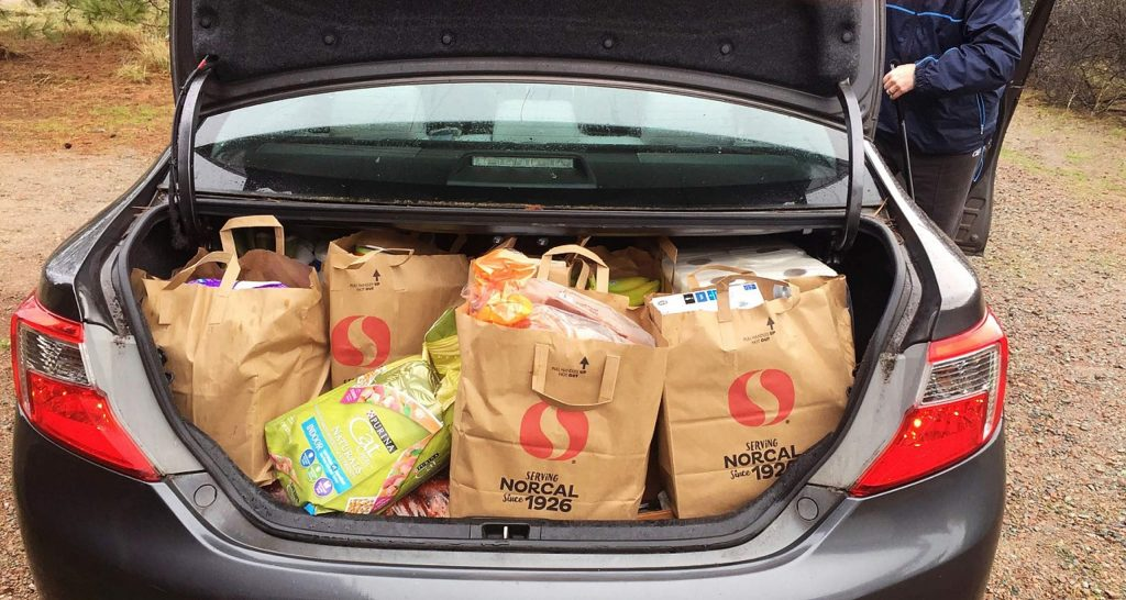The car all packed for Christmas travels.