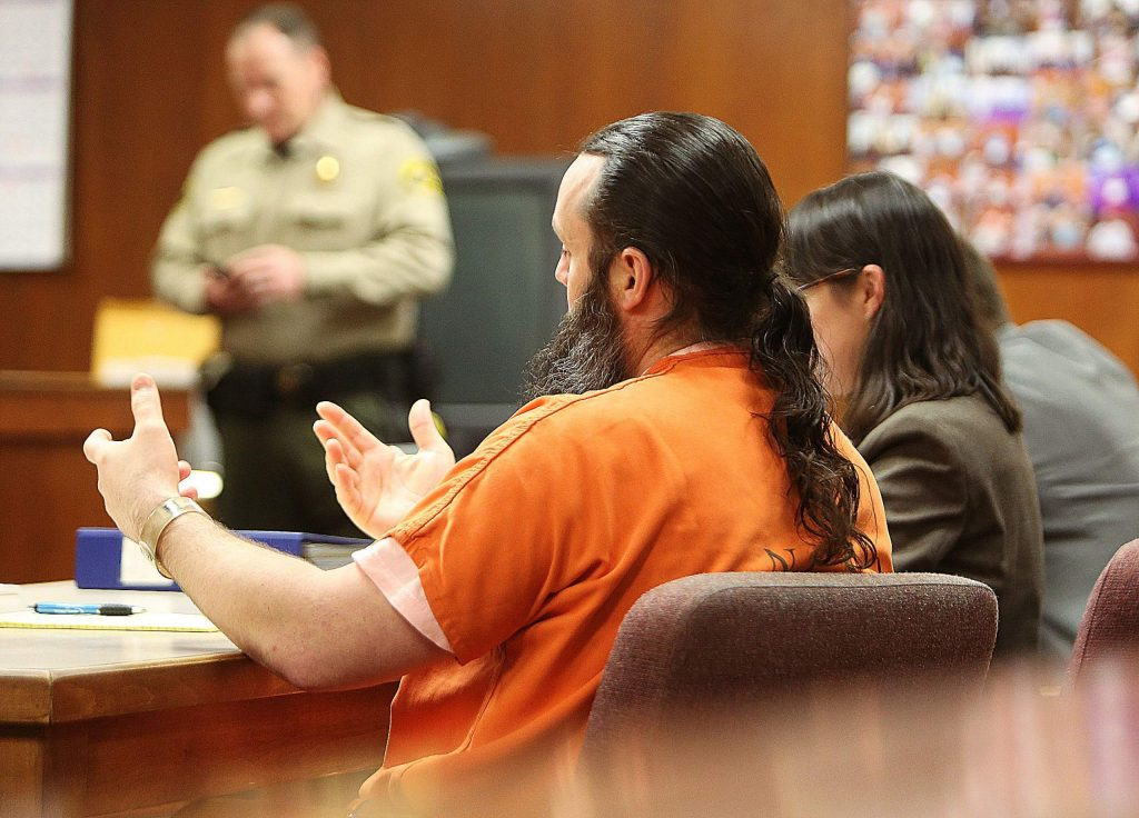 Pocock confers with his legal counsel during Tuesday's preliminary hearing at Nevada County Superior Court.