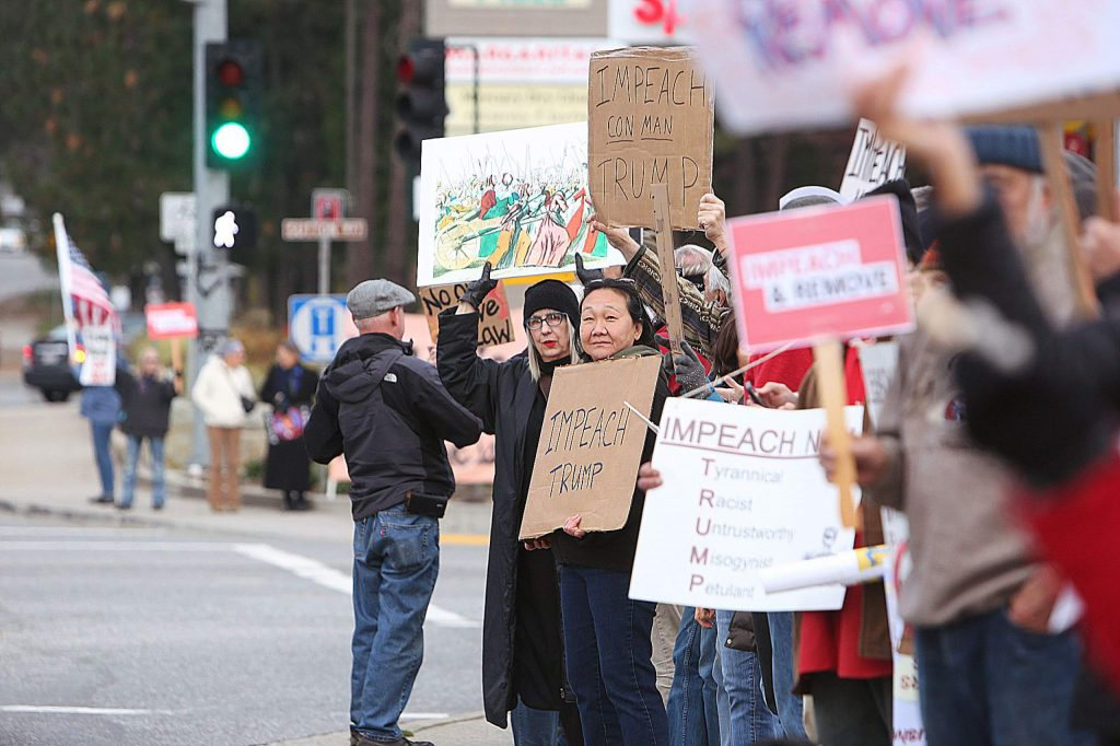 All four corners of the Brunswick Road and Sutton Way intersection were inundated with impeachment supporters.