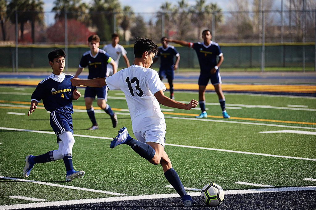 Nevada Union's Jaden Burcher-Cummings (13) readies to cross the ball during a game at the Inderkum boys soccer tourney in Sacramento.