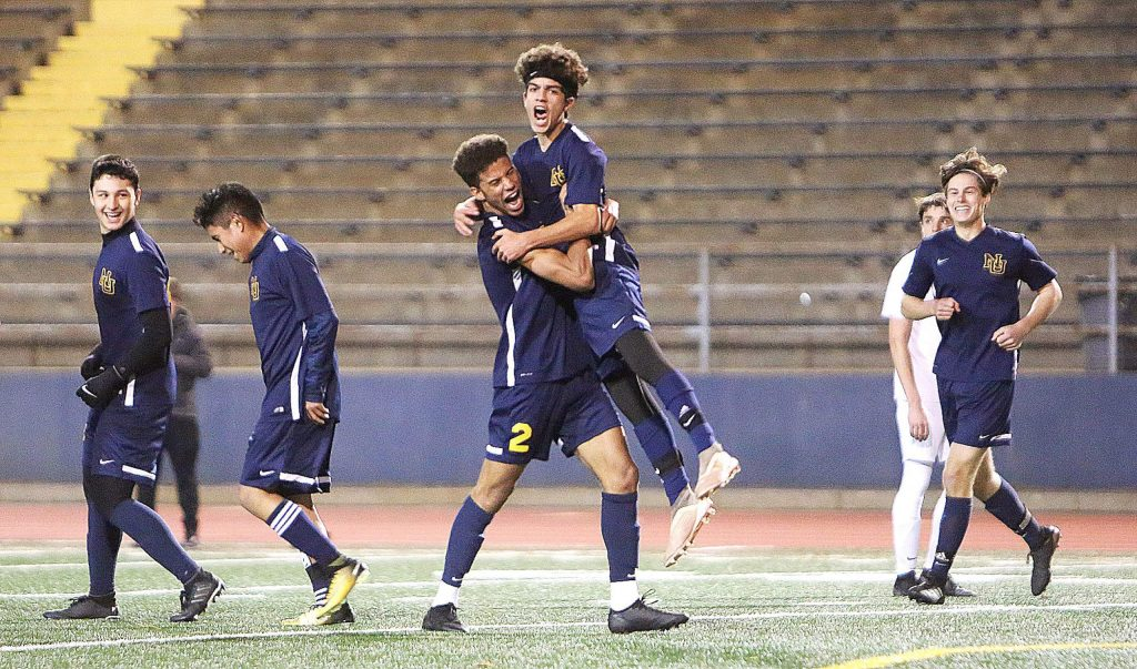 Nevada Union forwards Josh Smith (2) and Isaiah O'Connell (14) celebrate after one of O'Connell's goals against the Bear River Bruins Tuesday at Hooper Stadium.