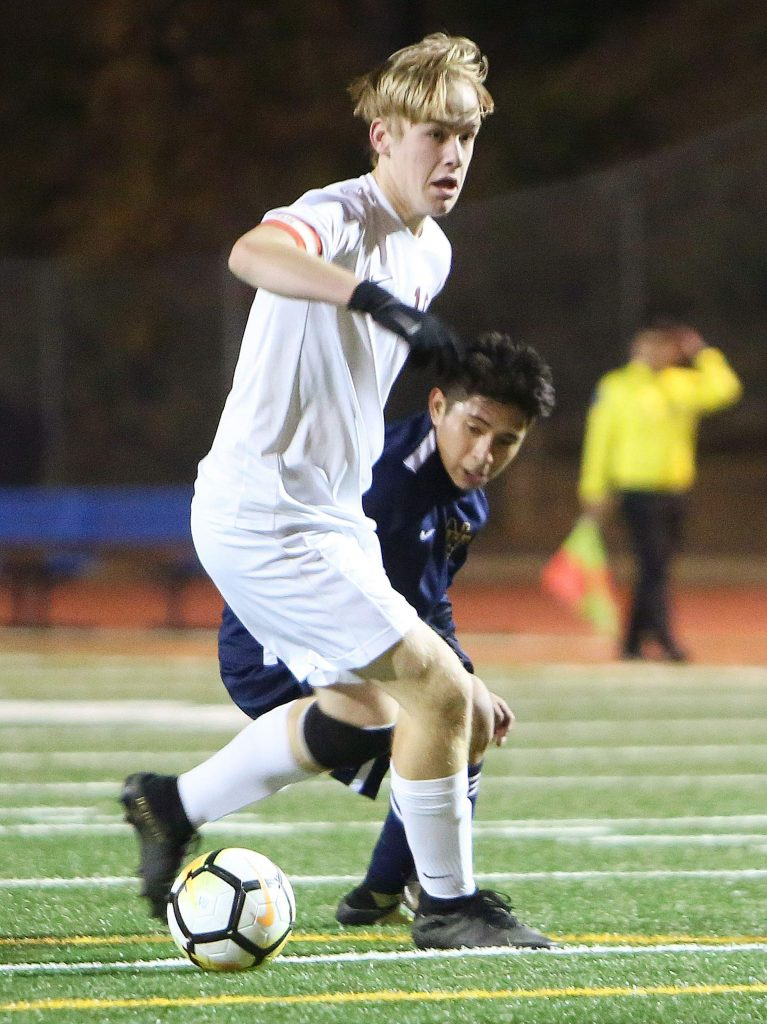 A Bear River player tries to keep the ball away from Nevada Union's Jose Hernandez Rivera (18) during Tuesday's matchup.