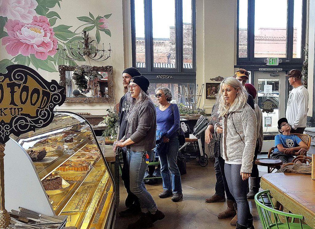 Visitors to downtown Grass Valley wait in line at Cake for treats and coffee Monday morning.