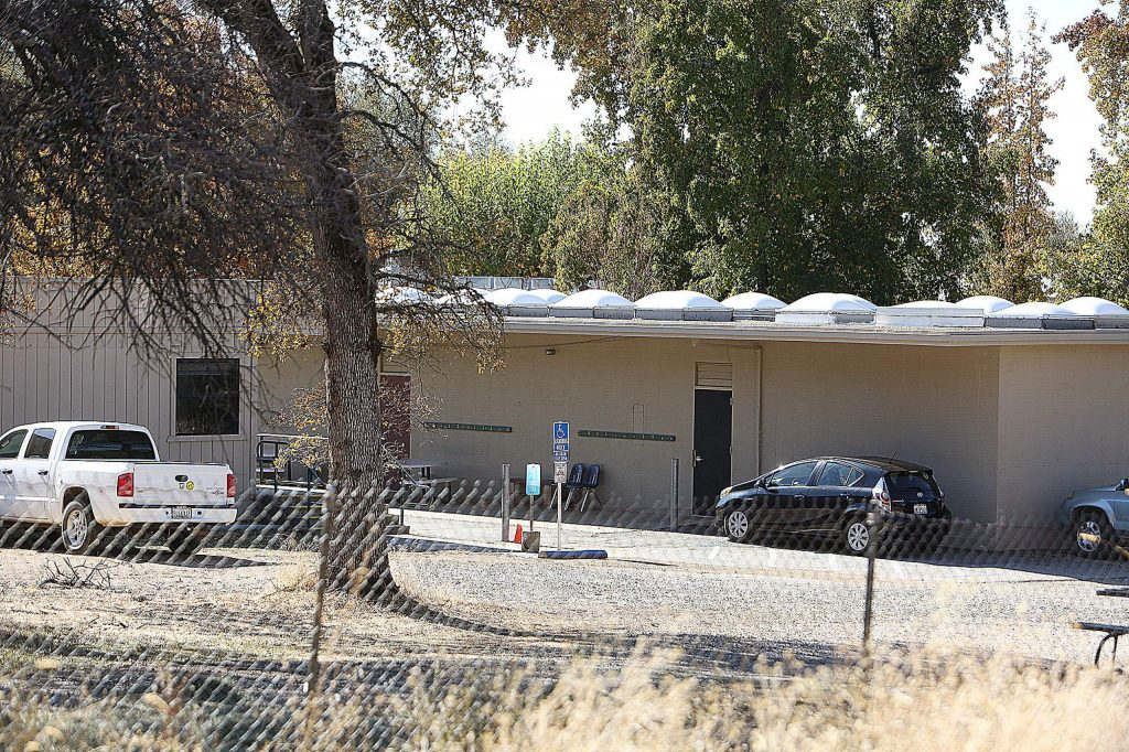 Staff vehicles are parked outside of classrooms on the Sierra Montessori Academy campus on the final day of classes Oct. 31.