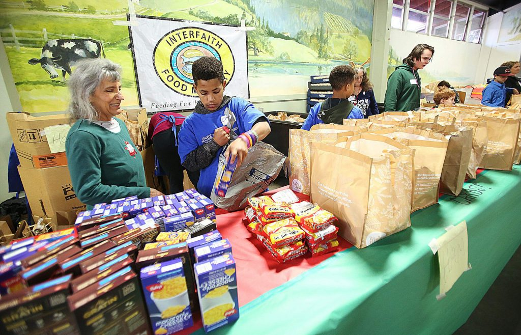 Volunteers from Interfaith Food Ministry were on hand to help distribute food including turkeys, hams, and much more.