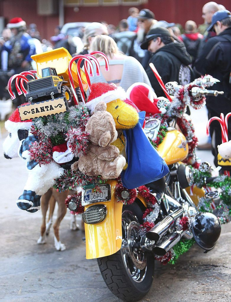 A decked out motorcycle laden with Christmas gifts arrives at the Nevada County Fairgrounds.