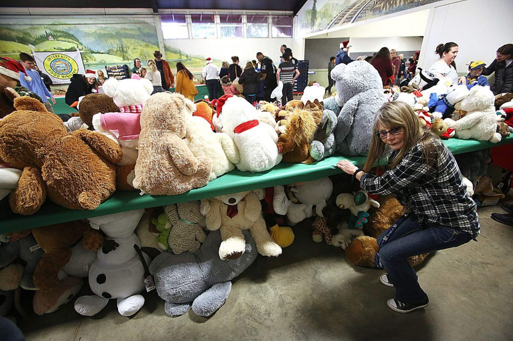 Piles of stuffed animals await to be given to area families and their children during Saturday's Food and Toy Run.