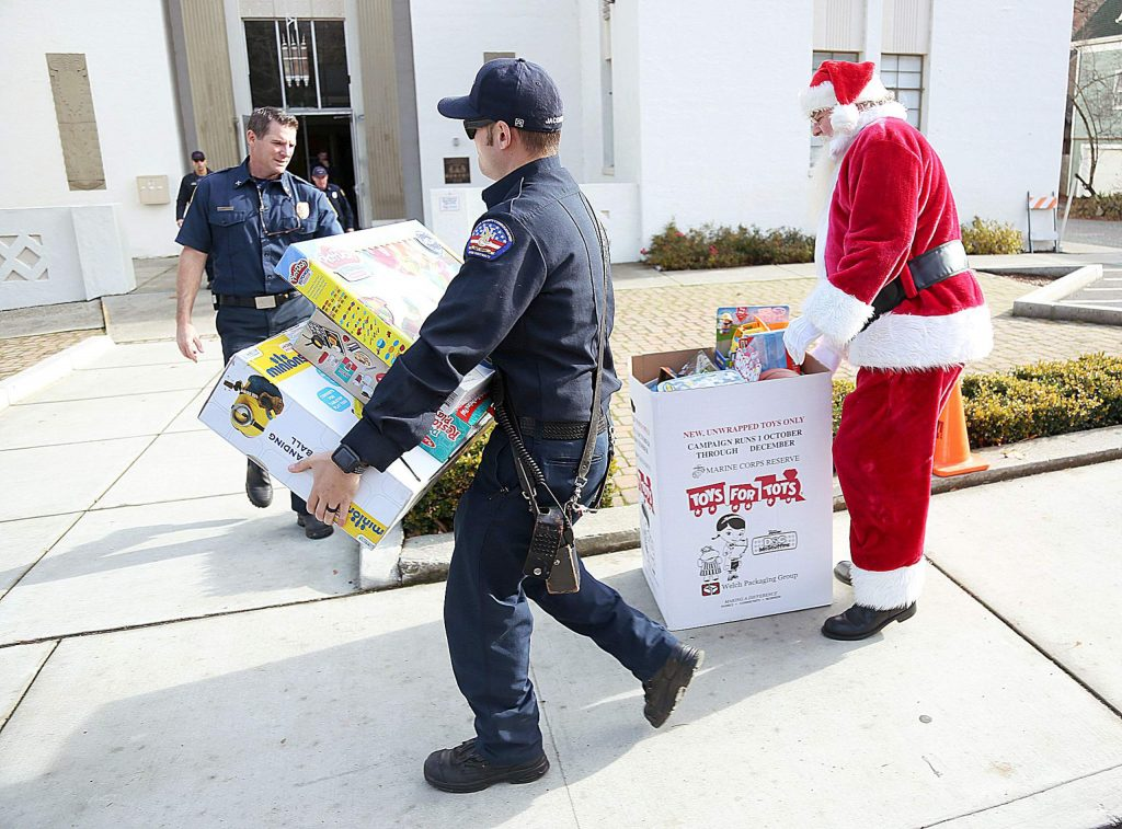 Representatives from local firefighting agencies kicked off the Toys for Tots giving season in Grass Valley Thursday when firefighters delivered a trailer full of toys to the Veterans Memorial Building on South Auburn Street.