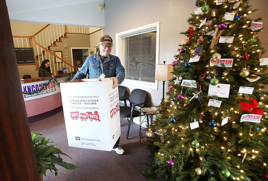 Jim Brodeur, senior vice commandant of the Gold Country Marine Corps League, carries a box full of Toys for Tots toys out of KNCO News Talk Radio and other locations Thursday. Volunteers will begin sorting the toys Thursday and today in preparation of a Saturday giveaway.
