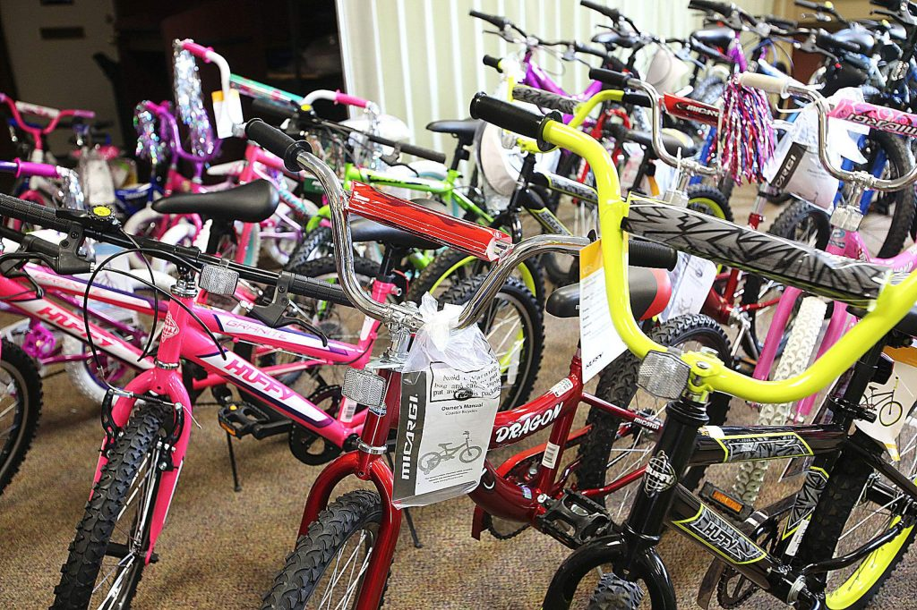 Shiny new bikes await their new owners at the Grass Valley Veterans Memorial Building, where the Toys for Tots giveaway is planned for Saturday. While toys for the younger kids are always abundant, there is still a need for gifts for teens.